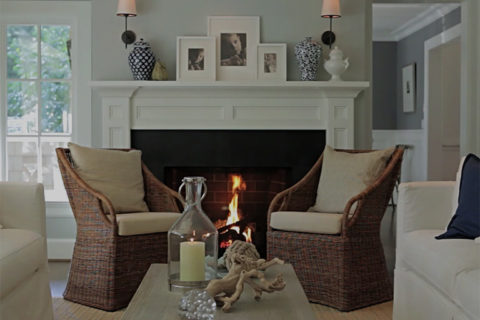 living room with fireplace in stylish home